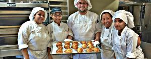 Baking & Pastry students with croissants